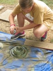Spray painting a safari hat in art